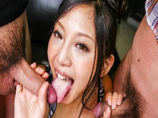 Eagerly Maki Takei goes down on two tasty cocks