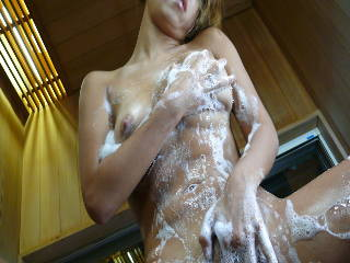 Raunchy Karen Yuuki teases while taking a shower