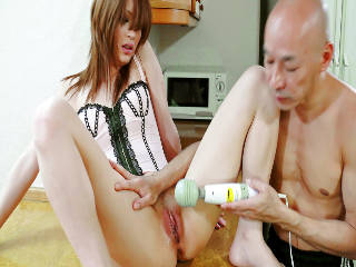 Pretty in pink Nana Kinoshita has her pussy toyed and fingered until she is soaking wet