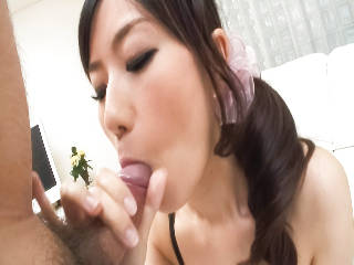 Talented Japanese AV model Manami Komukai uses her special tongue talents on a horny guy.