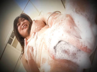 Giggly Nozomi Hatsuki enjoys putting shaving cream all over her sweet body.