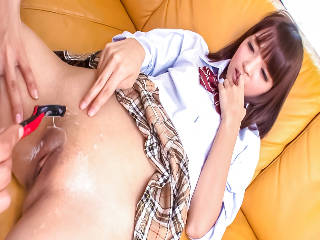 Rin Yuzuki in a school uniform shows off her shaved twat for the cameras