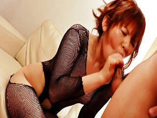 Reina Sakai in black fishnets with her horny guy sucking his dick until he erupts a geyser of cum